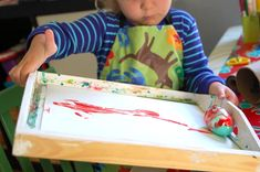 Fun Easter craft for toddlers: Using a plastic egg and a tray to paint.