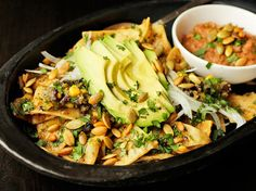 Vegan Chilaquiles with Pepitas, Charred Corn, and Black Beans