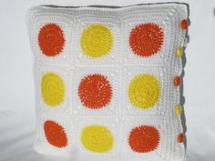 Orange and yellow dotty crochet cushion with insert on Etsy, £30.73