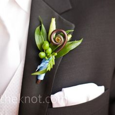 Again, not familiar with boutonniere's but I think this is neat and different.  Like the colors.  Fiddlehead fern and ranunculus bud