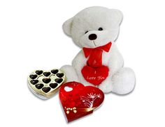 A cute lovable teddy bear with a heart(35cms) along with a heart shape box full of chocolates!           Love Bear (appx. 35cms)comes alive with a heart shape box full of chocolates to surprise someone with this exclusive hamper! A perfect love gift which would go out of stock soon.So don't delay and order today!