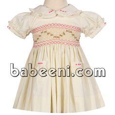 Cream geometric smocked dress for little girls  http://babeeni.com/Detail-cream-geometric-smocked-dress-for-little-girls---dr-2250-6111.aspx