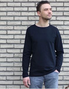 The Men's Breton T-shirt PDF sewing pattern is a straight T-shirt with long set-in sleeves. The boat neckline is folded under and stitched. A Breton T-shirt is characterized by a simple straight silhouette, slim body, and set-in sleeves. T Shirt Sewing Pattern, Mens Sewing Patterns, Sewing Magazines, Slim Body, Sport Casual, Casual Tops, Going Out, Classic T Shirts, Long Sleeve