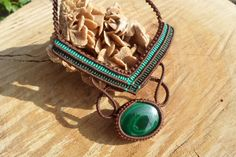 handmade macrame gemstone necklace with malachite cabochon and adjustable length.