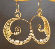 Hammered swirl hoop earrings wrapped with by CalicoJunoJewelry