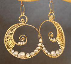 Hammered swirl hoop earrings wrapped with ivory pearls Cosmopolitan 50