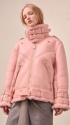 This item may take 1-2 weeks in production processing. Additional items purchased within the same order will be shipped out together after its arrival. The Kaelin Shearling Jacket in mauve pink. Moto-