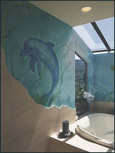 Imagine bathing with a dolphin! The custom mural adds a delightful bit of whimsy to this sophisticated tub-shower room.