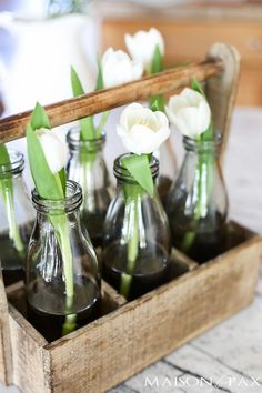 Single stem tulips in a rustic wood bottle caddy... Tips for quick and easy decorating with flowers | http://maisondepax.com