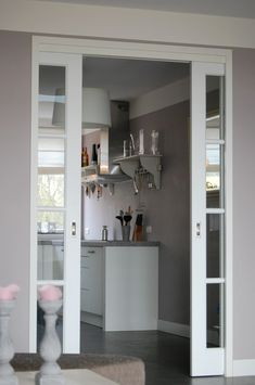 I love pocket doors and it's unusual to see them with glass panels. nice way to get more licht into interior spaces House, Interior, Home, Living Room Style, House Interior, Home Deco, Doors And Floors, Home Kitchens, Home And Living