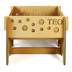 Finnish cardboard cradle crib for children. Lightweight, sturdy, custom designed by Cartonlab. #finnishcradle #cardboardcradle