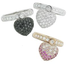 Rings in white and yellow gold , pink sapphires, white and black diamonds