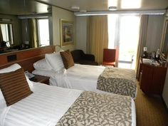 Nieuw Amsterdam cruise ship tour and review, with information on the interiors, exteriors, dining, cabins, and bars