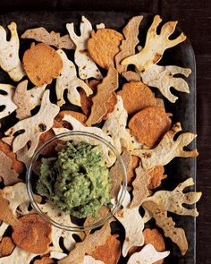 Guacamoldy with Creature Chips - Make the most of avocado's mold-colored hue by serving it alongside chips cut into a creepy shape.