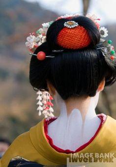 Geisha's neck the red in the hair represents a virgin or Maeko
