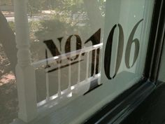 House numbers negative etch/ frost on front door window.