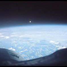 Photo of a full moon over the Pacific, taken by the Gemini 7 crew.