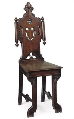 A VICTORIAN GOTHIC REVIVAL OAK HALL CHAIR -  LATE 19TH CENTURY