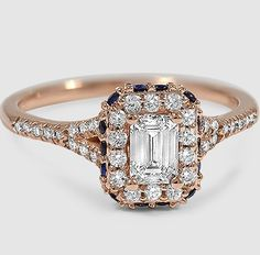 Vibrant sapphires set around the edge of a diamond halo add a regal touch to this glamorous setting.