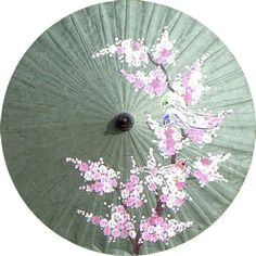 This beautiful parasol is hand crafted and hand painted by artisans in Thailand - such a delicate rendering of flowers....