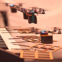 "Nanobot music from Prof. Vijay Kumar: quadcopters, servos and instruments. Yup, the ""other"" Kumar is more entertaining."