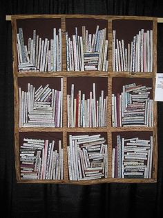 Omgosh, this is awesome! A bookshelf quilt made from selvedges. I wish I knew who the quilter was to give proper credit! This is amazing!