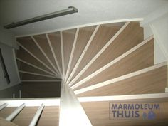 Marmoleum Striato series used on a flight of stairs.   www.notablerugs.ca