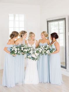 All shades of blue bridesmaids dresses: Photography: Tenth and Grace - http://www.tenthandgrace.com/
