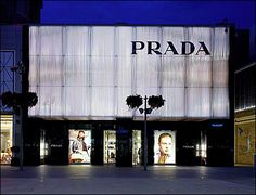 Prada launches its new store at Westfield Stratford City (design, architecture, fashion, prada) Retail Facade, Shop Facade, Uk Retail, Retail Signage, Prada, Facade Lighting, Wallpaper Magazine, Small Buildings, Fashion Wallpaper