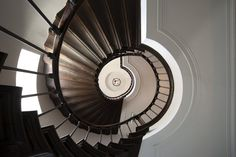 An Empire style spiral staircase in an historic Belgian home renovation by Glenn Reynaert | Photo: Hendrik Biegs | DPAGES