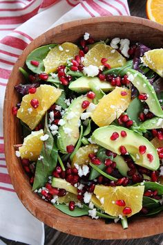 This pomegranate, orange, and avo salad is a punch of color and flavor!