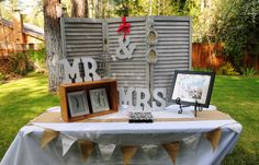 """Rustic shutter are the perfect back drop for your guest book table.  I just love the """"Mr & Mrs"""" letters as well."""