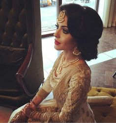 Pakistani bride in an off-white & gold bridal.