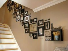 Picture frames on staircase wall: I love this look; unified though with a lot of variation in frame types, some of the items on the wall aren't even pictures. Picture frames on staircase wall: Wall Decor, Decor, Picture Hanging, Stairway Photos, House Design, Home Projects, House Interior, Interior, Home Decor