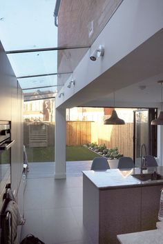 Modern Kitchen Design : VCDesign is loving this side return extenaion with sheer glass roof to the side Interior Architecture, Interior And Exterior, Interior Design, Conservatory Kitchen, Glass Extension, London House, Roof Light, House Extensions, Patio Roof