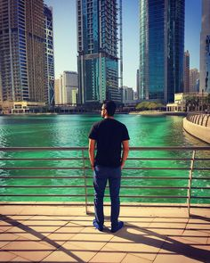 Better days are coming. They are called Friday and Saturday  #njlifemoments . .  #instadaily #waiting #for #weekend #friday #saturday #weekendvibes #peace #alonetime #green #water #lake #skyscrapers #amazing #view #sunnyday #taking #vitamin #d #great #weather #black #tshirt #blue #loafers #dubailife #iphone #photography #mydubai
