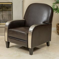 The Oliver Recliner Chair offers a unique blend of industrial and contemporary design elements. Upholstered in brown bonded leather, the armrests are adorned with metal accent that are further complemented by the matching nailhead accents that line the top of the backrest. The chair recliner mechanism, releases the footrest and backrest to allow users to sit back with ease. A convenient and stylish piece, you can enjoy the Oliver recliner in any room. Features:Upholstered with brown bonded…