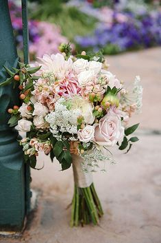 blush wedding bouquets small with dahlias roses and greenery brooke schultz photography via instagram