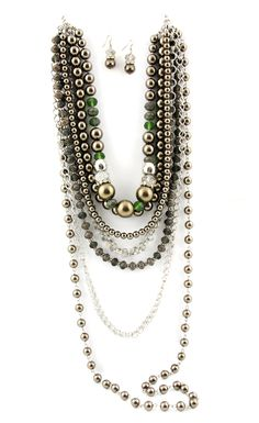 """Product # JN0620  7strand chocolate pearls & silver chain accented with rhinestones and green  35"""" with 5"""" extender    Price: $39.00"""