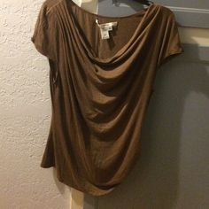 Studio M brown top Studio M brown top.  Very soft, lightweight top perfect for summer. Nice pleat detail on left shoulder, drape neckline and flattering ruching on right bottom.  Brand new, never worn. NWOT Studio M Tops Blouses