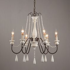 Dress up your home with this graceful wooden bead swag chandelier. Wooden bead strands swag and drape elegantly scrolling arms to give a timeless, elegant boost. Dangling teardrop ornaments echo the theme and draw the look together. Heavy metal in rust French Country Bedrooms, French Country Style, French Country Decorating, French Country Cottage, French Country Kitchen Decor, Country Farmhouse, Rustic Style, Country Living, Wooden Chandelier