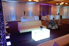 White leather lounge furniture with lighted cube tables.