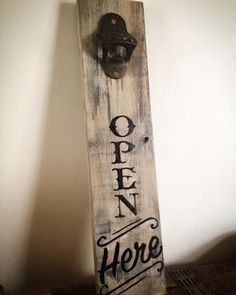 Handmade wall mounted bottle opener. Created using reclaimed wood, painted with Annie Sloan Chalk Paint for a distressed look and One Shot signwriting paint for the lettering, finished with a cast iron bottle opener.