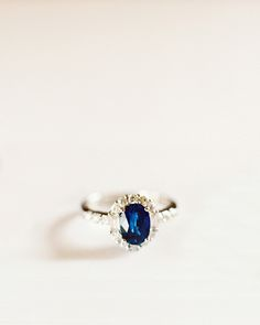 Sapphire Engagement Ring. Man, as a teenager my mom had given me a beautiful ring like this one. I wish I still had it.