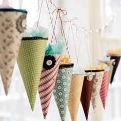 Rolled printed and decorated paper hung up on a string and filled with goodies