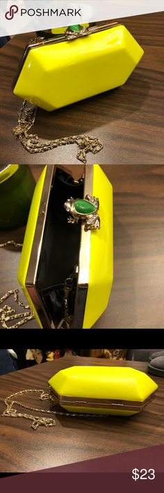 Also bright yellow clutch with gold chain! Used in very good condition. Been used twice! Just a tiny mark at the bottom as shown on the pic. Very hard to see! Aldo Bags Clutches & Wristlets