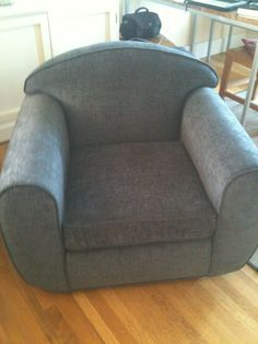 Reupholstered Over Sized Single Cushion Chair with Piping.
