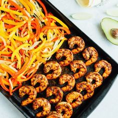 These sheet pan shrimp fajitas make for an easy weeknight meal! Simply bake your shrimp and veggies on one sheet, load up your tortillas and enjoy!