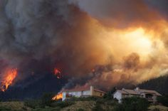 Fire from the Waldo Canyon wildfire as it moved into subdivisions and destroyed homes in Colorado Springs, Colo., on Tuesday, June 26, 2012. Photo: Gaylon Wampler / AP
