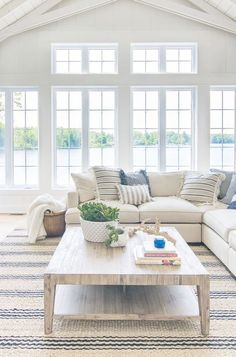 Cozy cottage living room with large windows to let in lots of light